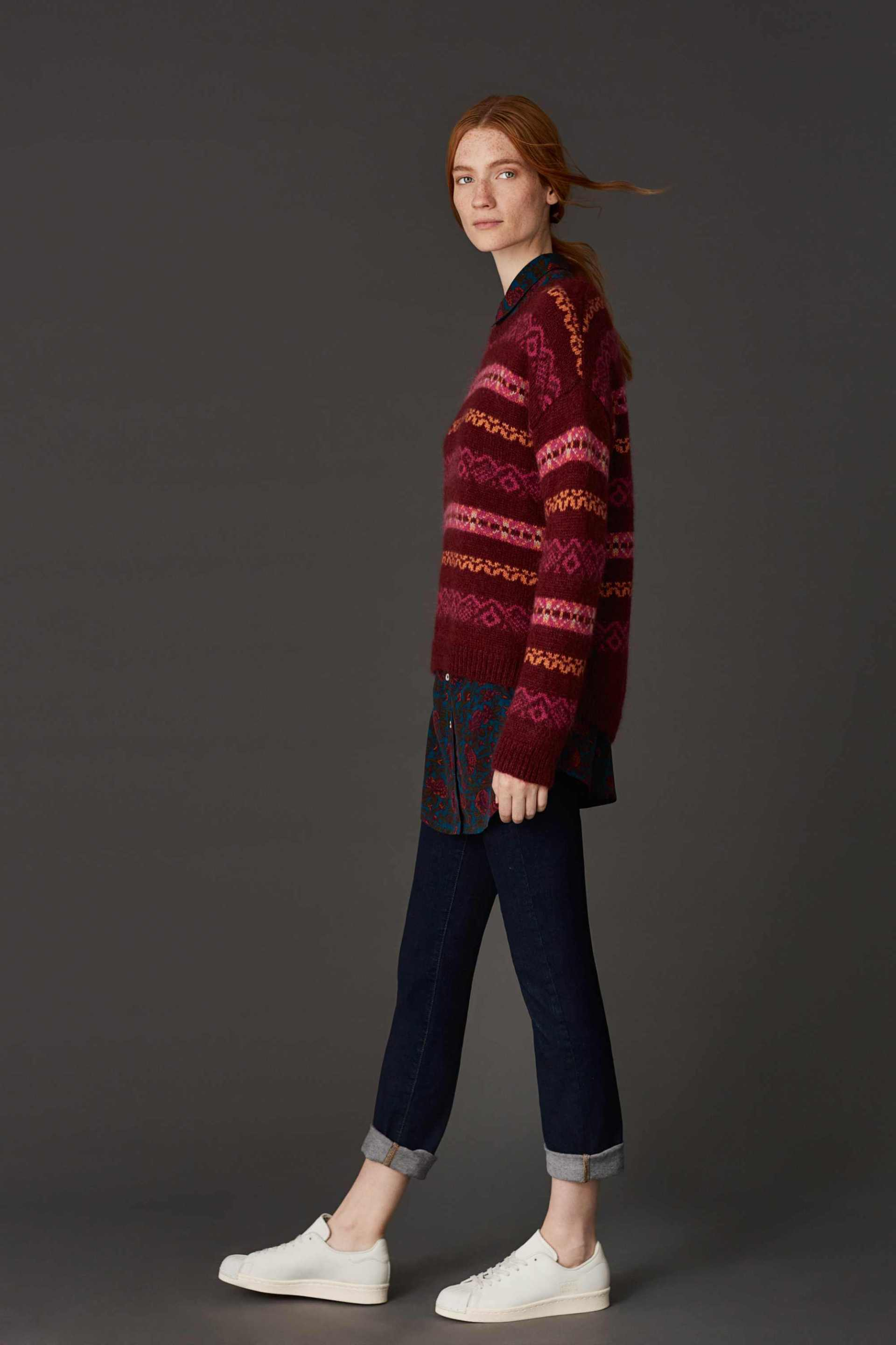 model wearing East Wool Blend Fairisle Jumper, £99; Silk Alicia Print Shirt, £149; Straight Leg Jeans, £69