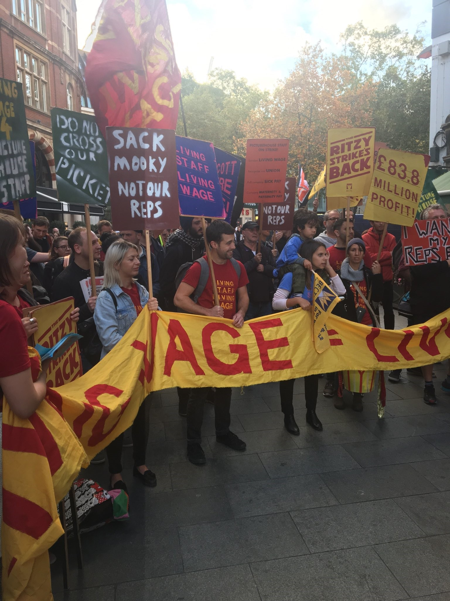 Protesters waving banners at the London event.