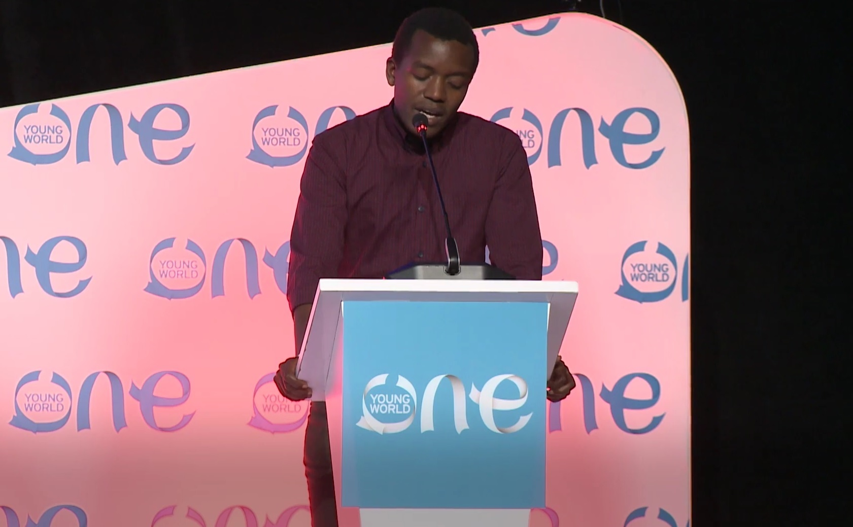 Hyppolite Ntigurirwa speaking at the One Young World conference in Bogota, Colombia (PA)