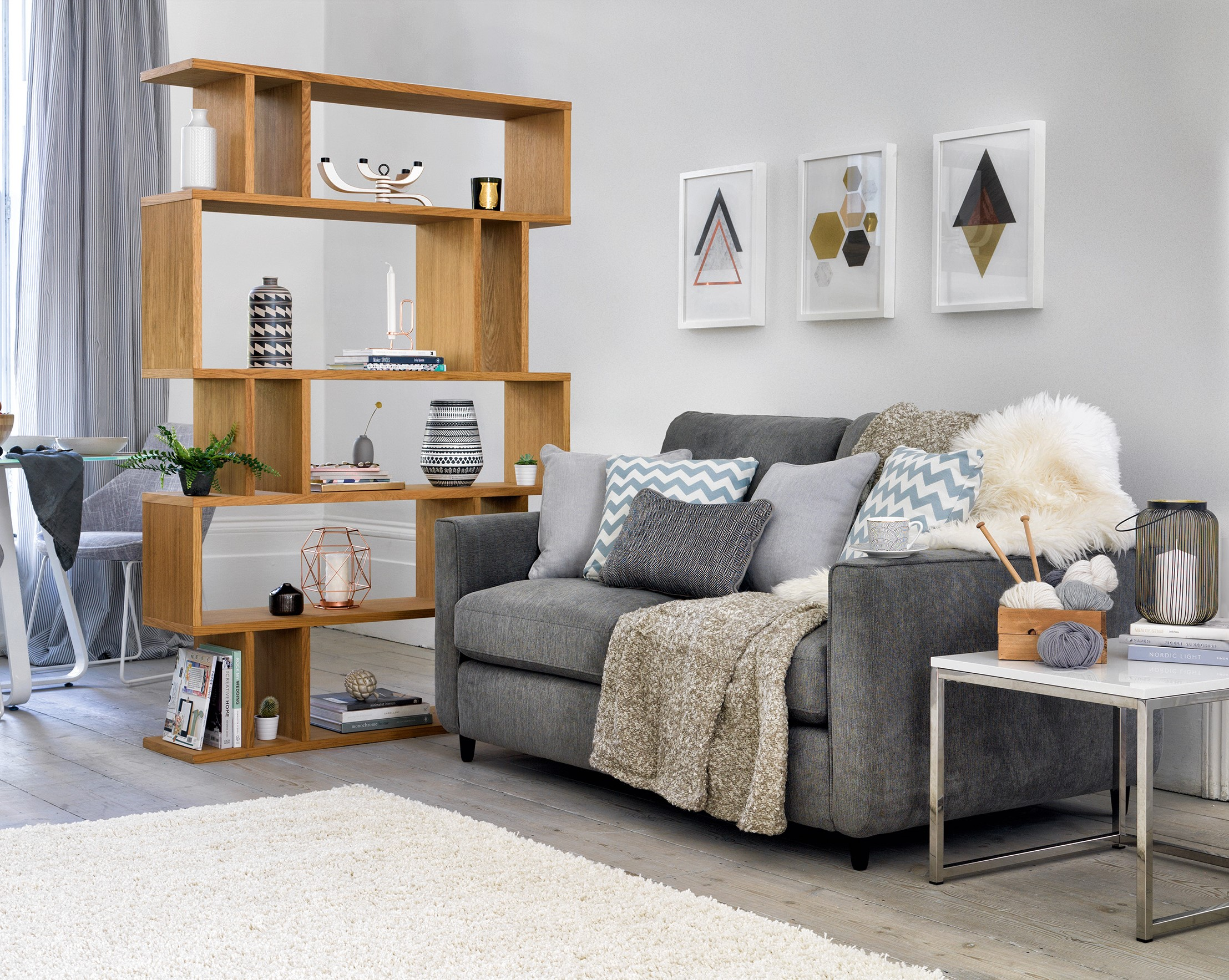 Esprit two seater fabric sofa, £549, currently reduced online to £499; Content by Conran Elmari tall shelving unit, £449, Furniture Village (Furniture Village/PA)
