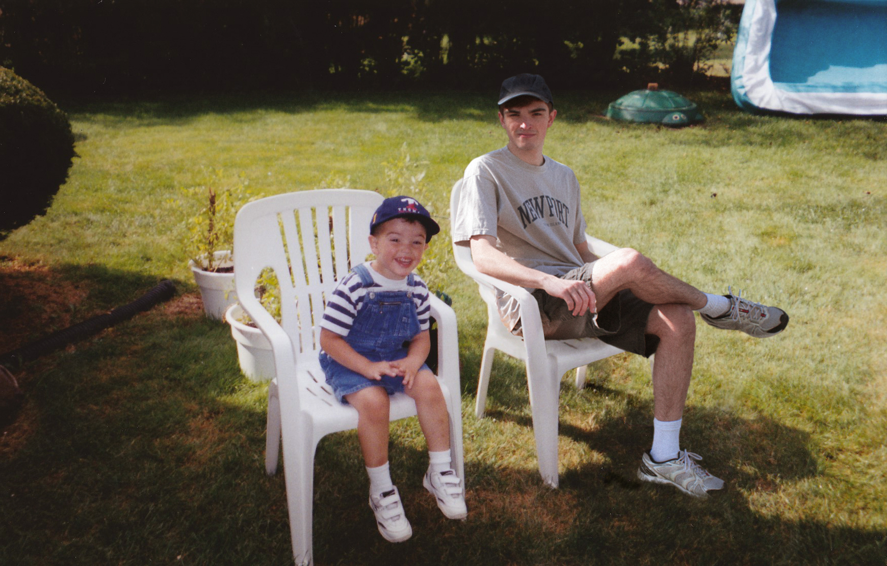 Conor and his younger self on chairs outside