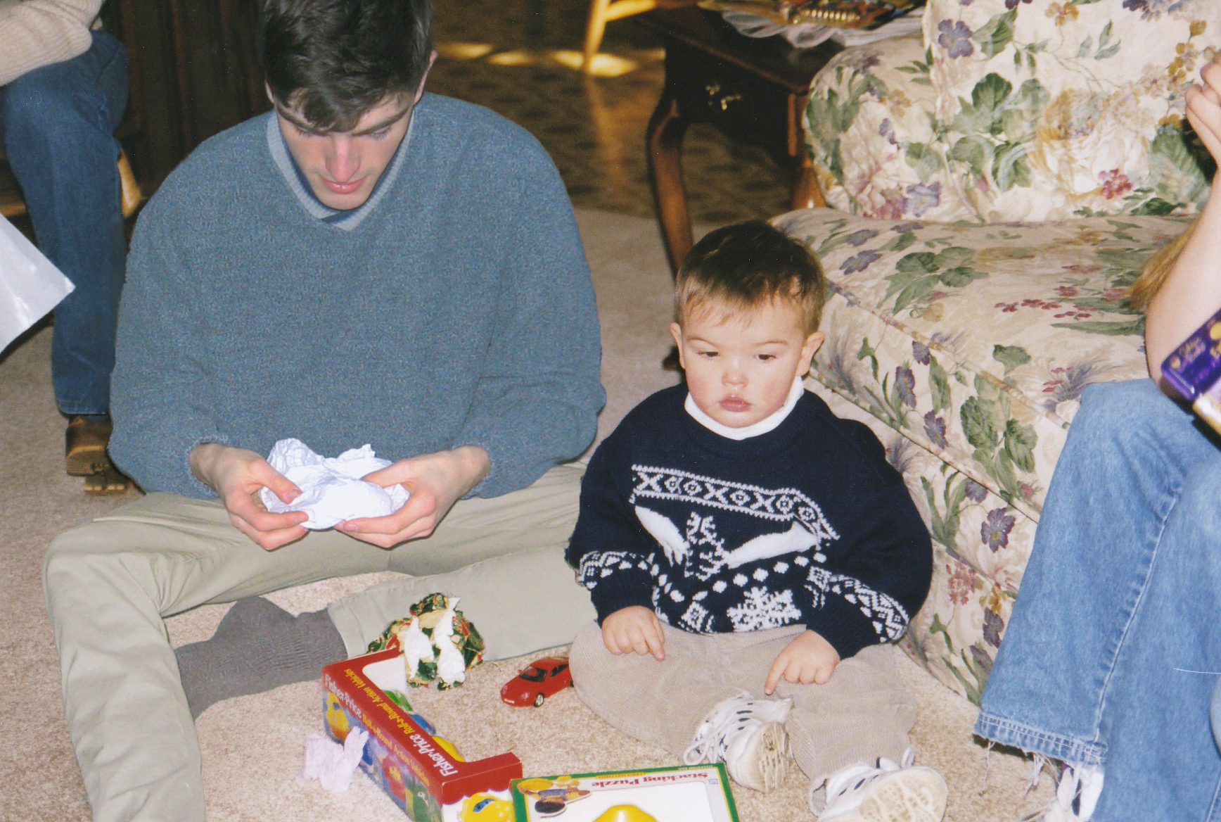 Conor and his younger self opening presents