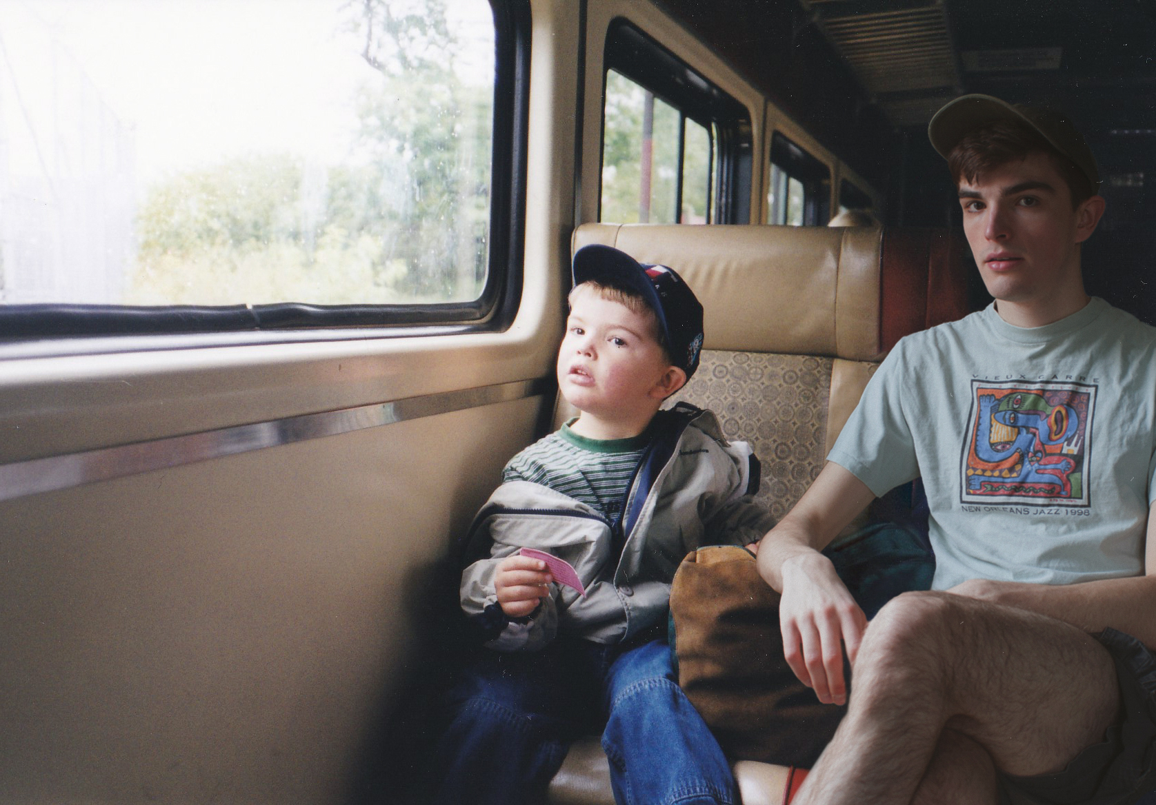 Conor with his younger self on a train