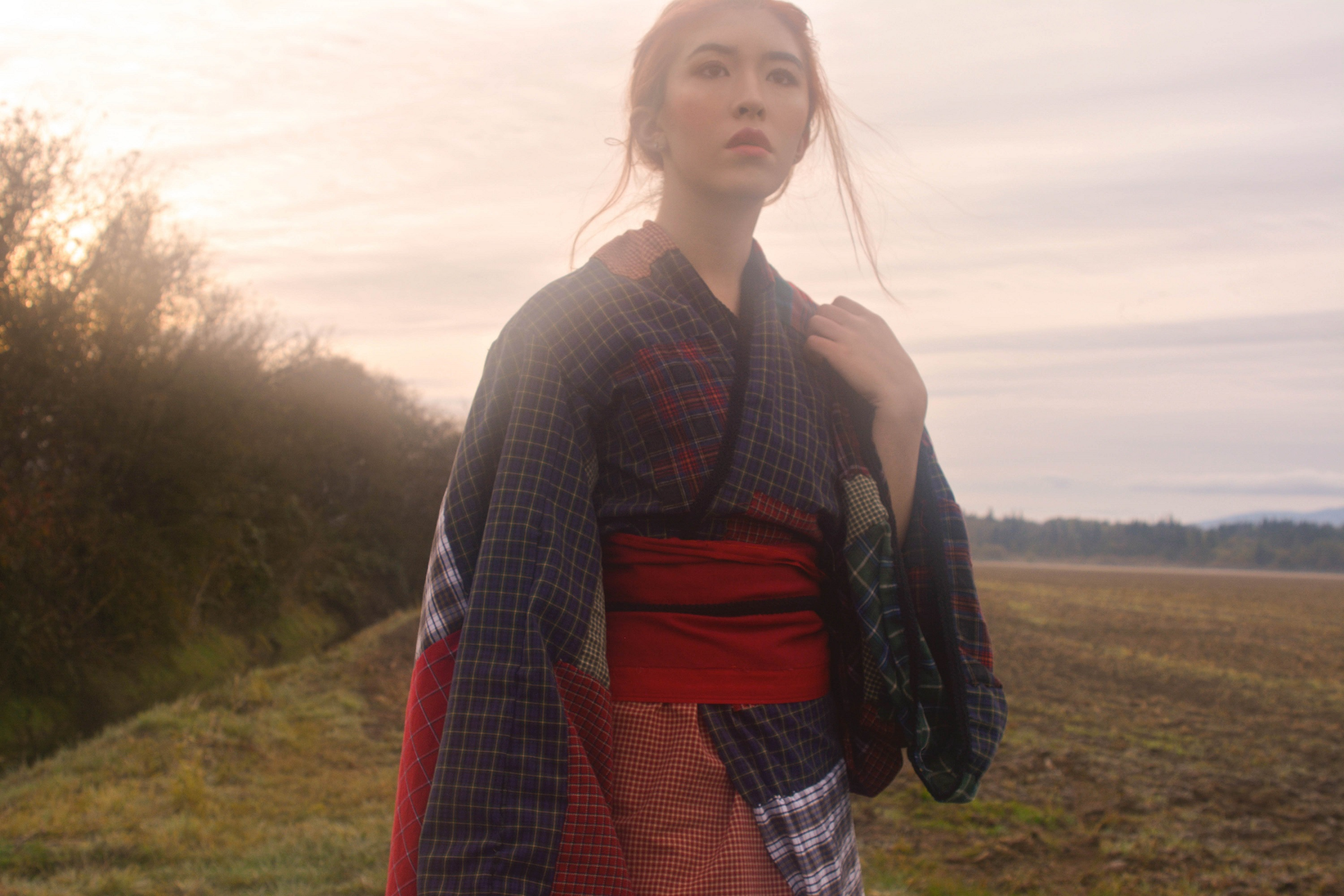 Maya in the kimono looking into the distance