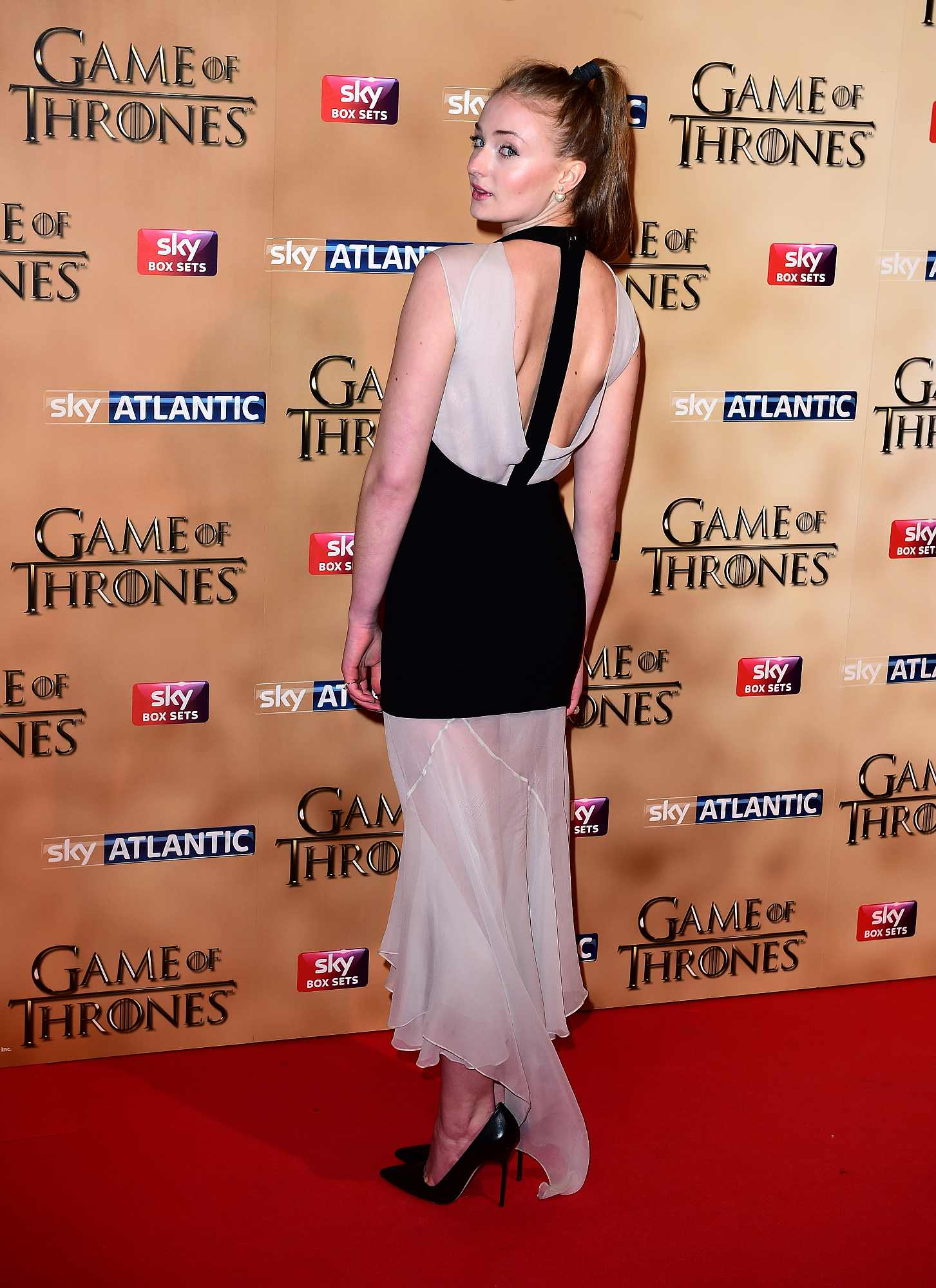 Sophie Turner attending the world premiere of the fifth series of Game of Thrones at the Tower of London