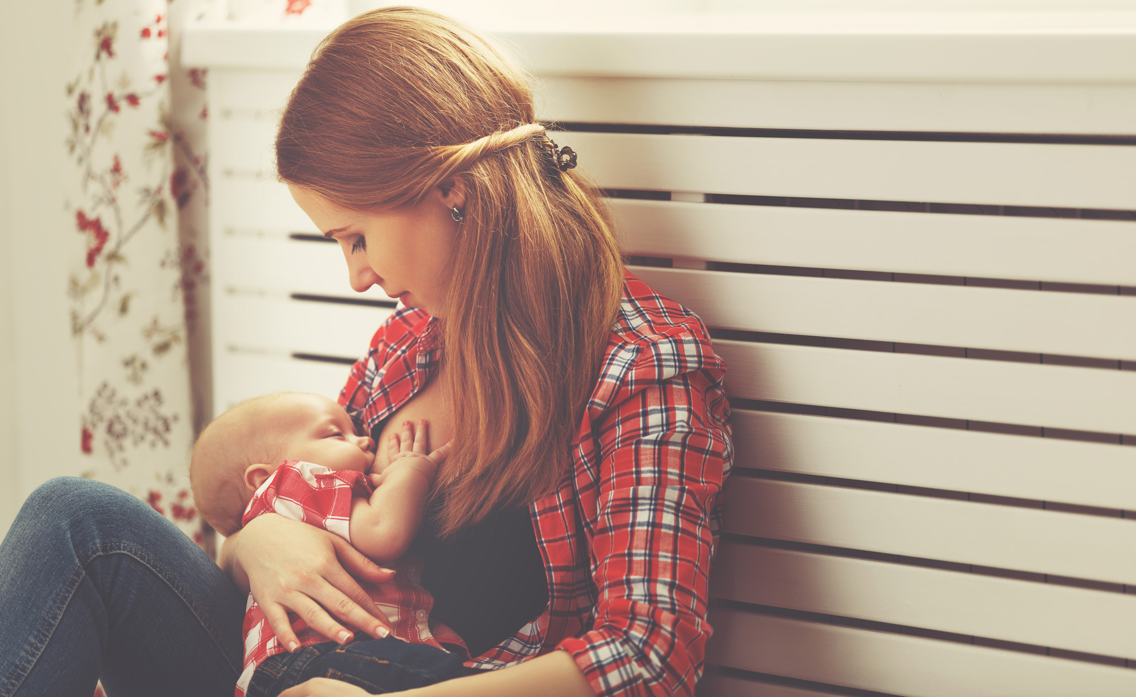 A mother breastfeeding her child (Thinkstock/PA)