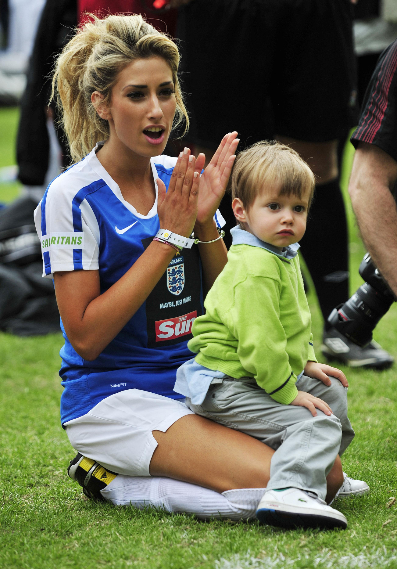 Stacey Solomon watches a game with her son, Zachary during the annual Soccer Six tournament at Charlton Athletic Football Club in 2010. (Tim Ireland/PA)