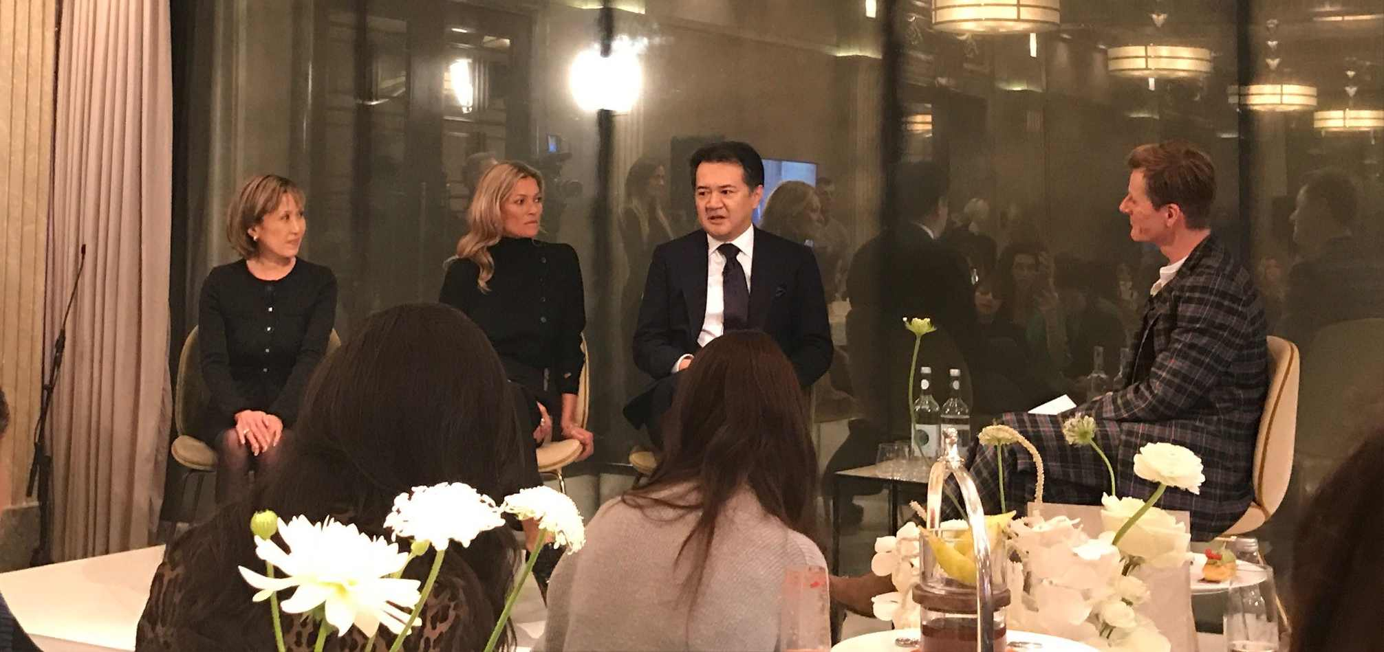Kate Moss and brand representatives on stage at the Decorte beauty UK launch event