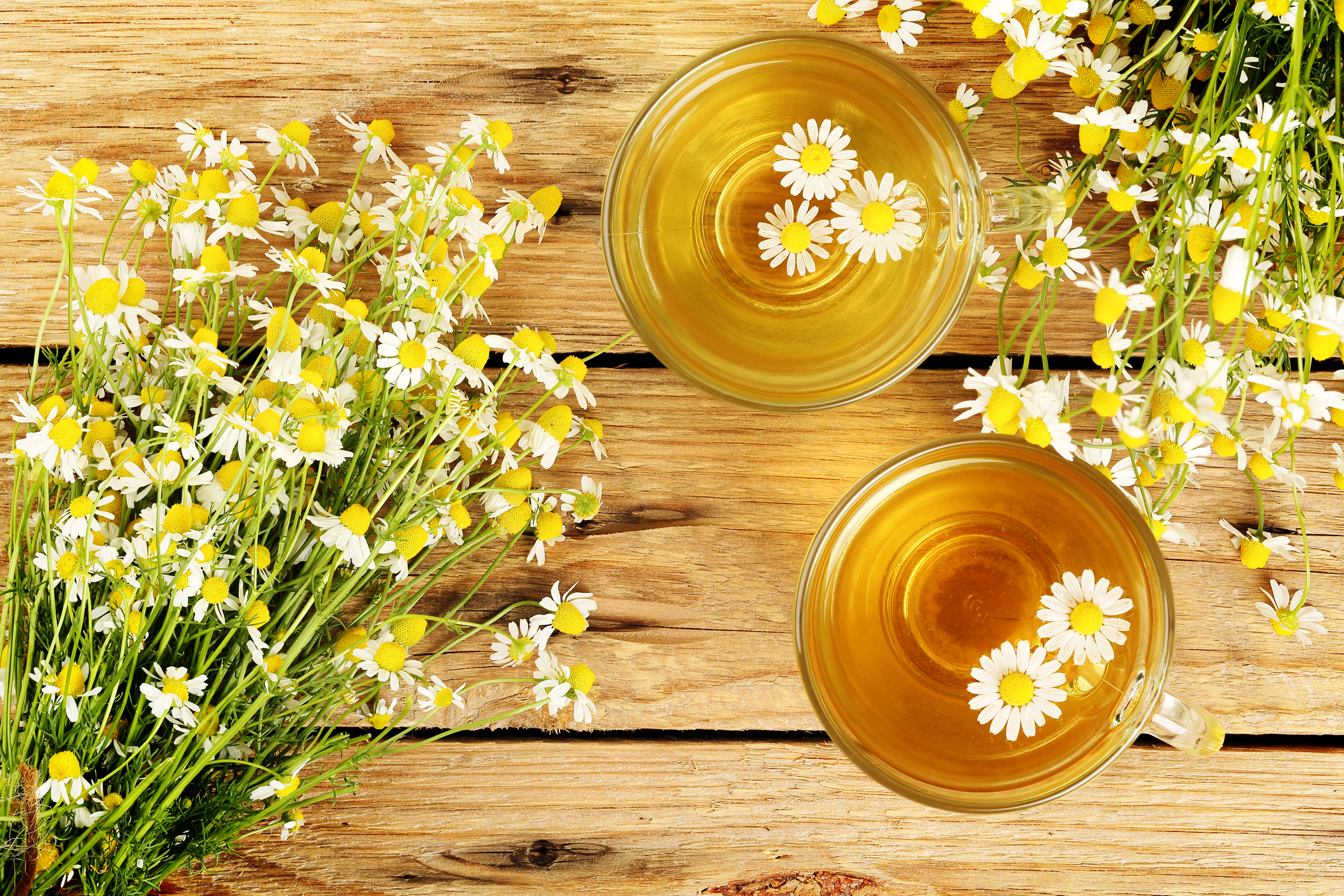 cups of chamomile tea with chamomile flowers on wooden planks (Thinkstock/PA)