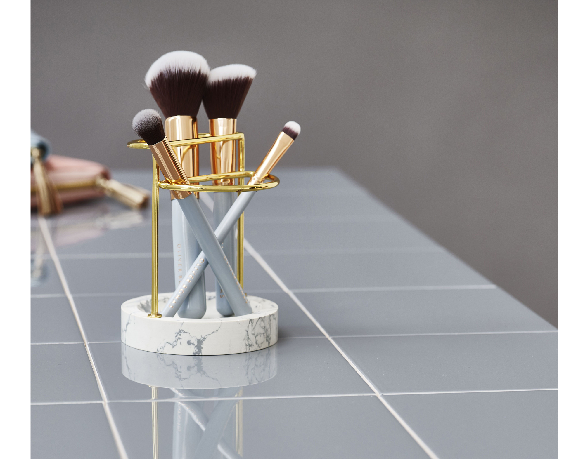 Stonedust Brush Holder, £24; Set of Make Up Brushes, £38 for pack of five with compact mirror, Oliver Bonas