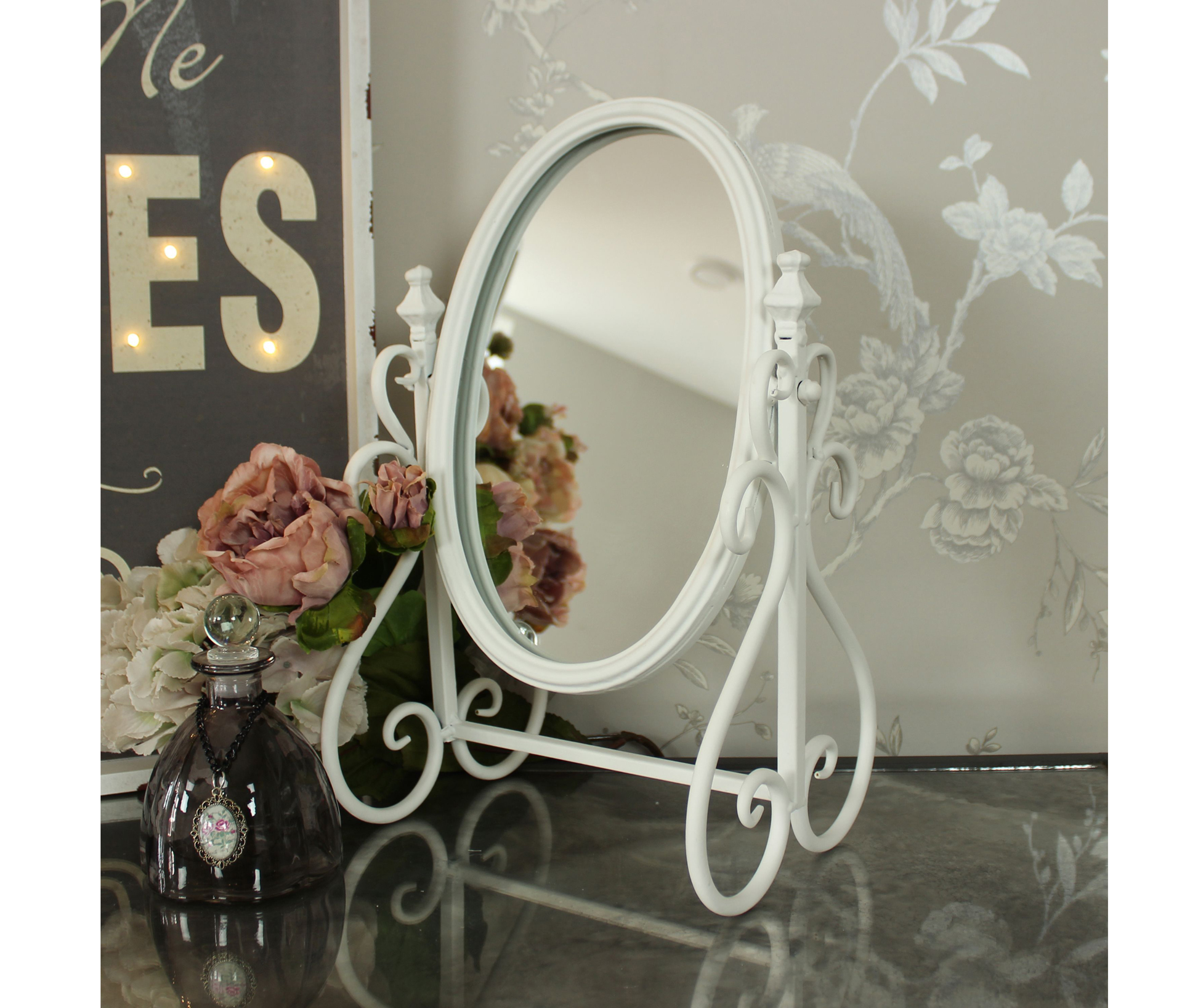 Ivory Metal Swing Mirror, £32.95, Melody Maison