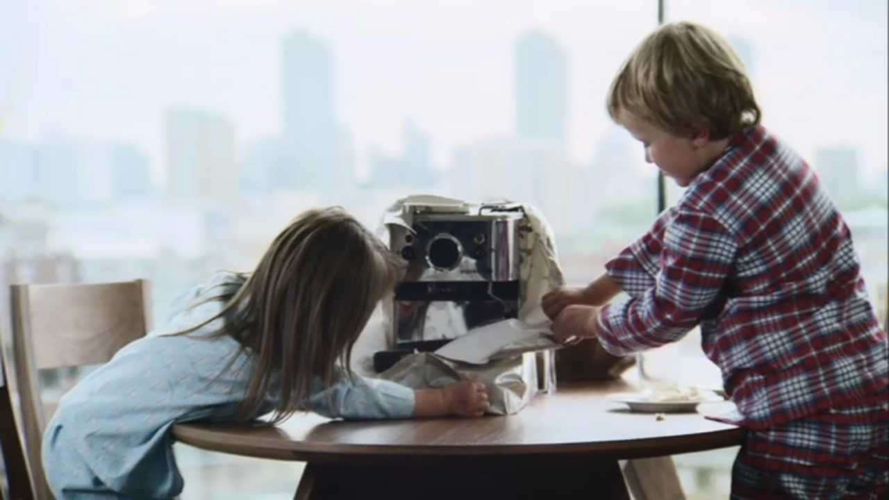 Children opening adult presents in the John Lewis ad - John Lewis/PA