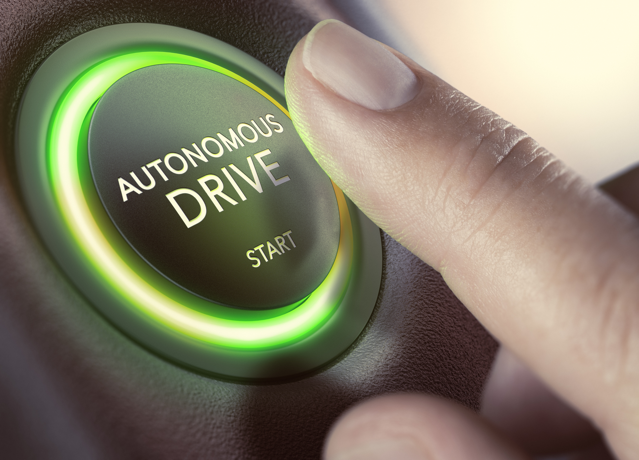 Finger ready to press start button on autonomous drive vehicle (Olivier Le Moal/Getty Images)
