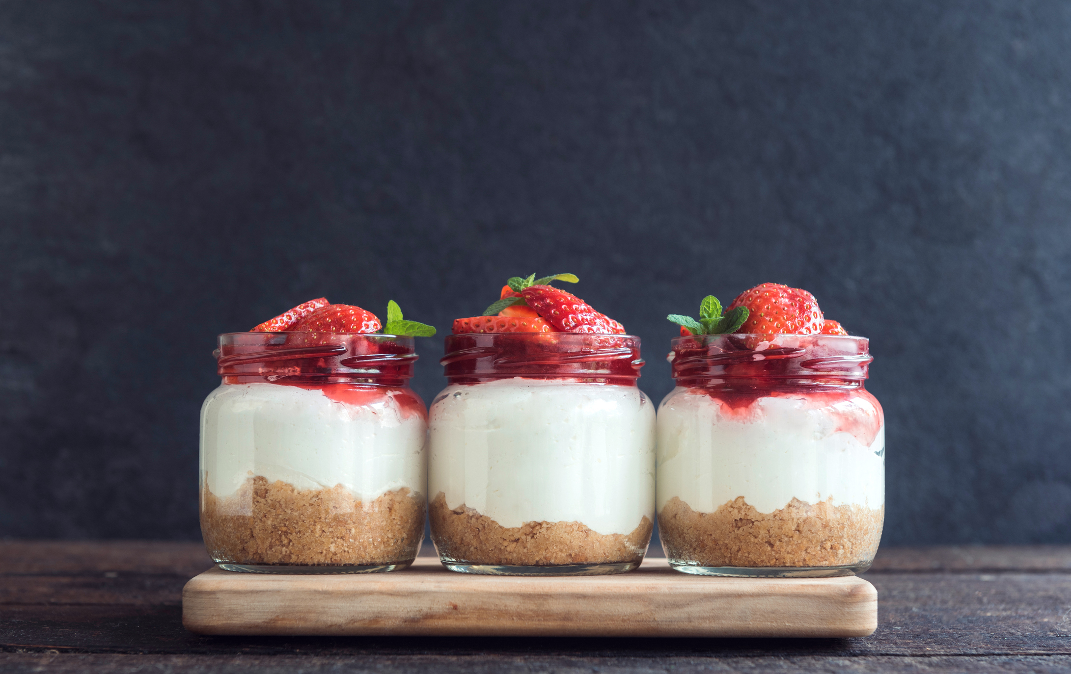 Sweet homemade cheesecake with strawberries in the jar on wooden background (Thinkstock/PA)