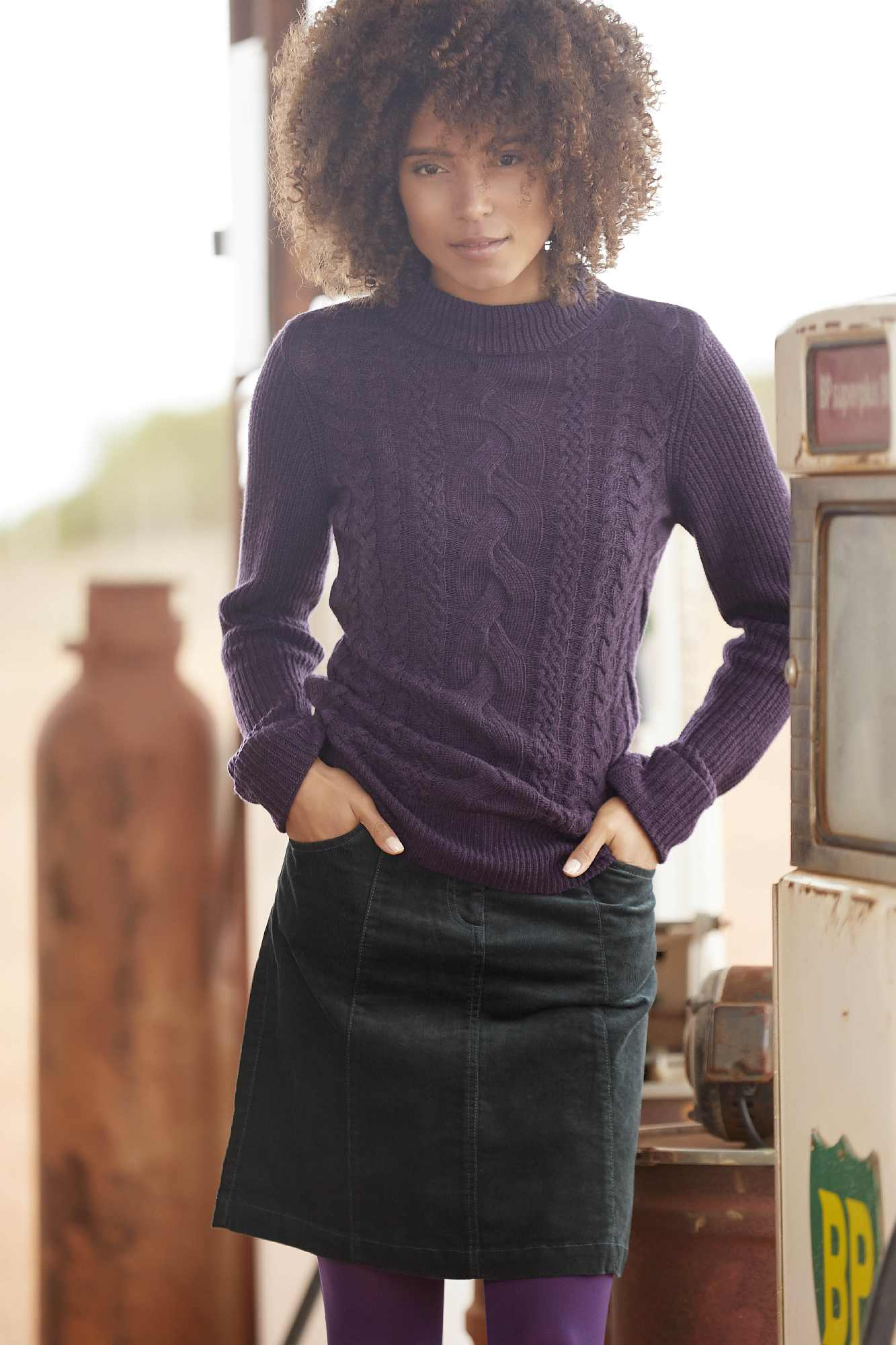 model wearing M&Co Petite Cable Knit Turtle Neck Jumper and Petite A-Line Cord Skirt