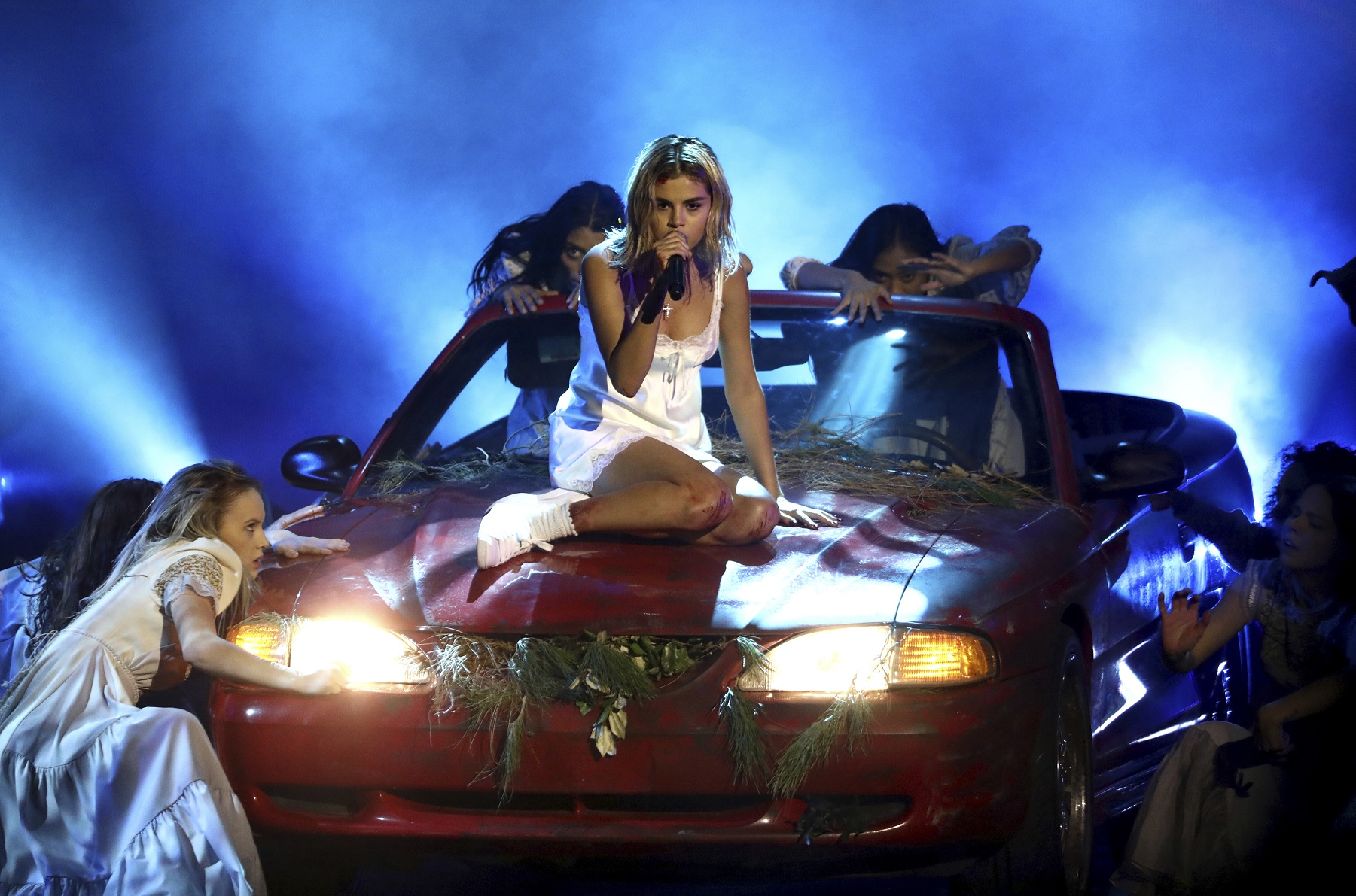 Selena Gomez performs Wolves at the awards (Matt Sayles/Invision/AP)