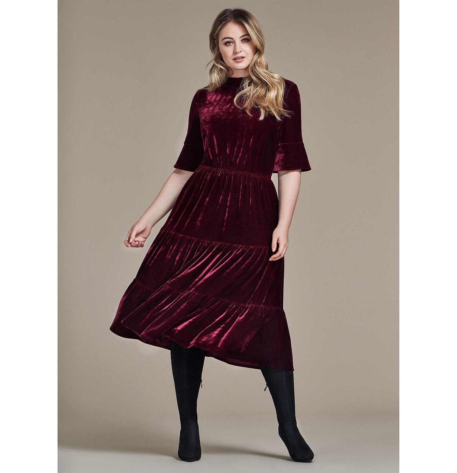 Model wearing SimplyBe Tiered Velour Dress and; Sole Diva Charlotte Boots