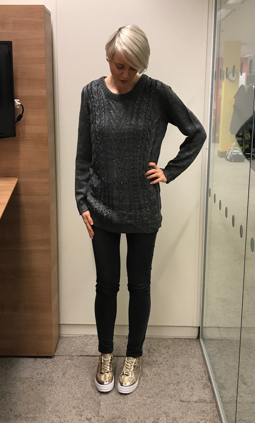 model wears grey jumper and metallic trainers from 10store.com