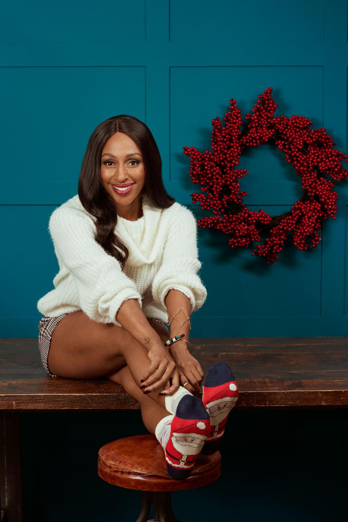 Alexandra Burke poses for TK Maxx's Christmas Sock campaign #socksie (Mikael Buck/TK Maxx/PA)