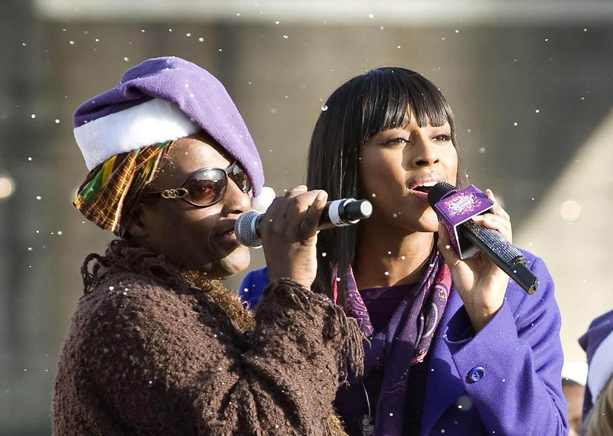 Alexandra Burke singing with her mother Melissa Bell, who was a member of the Grammy-winning group, Soul II Soul. (Matt Crossick/PA