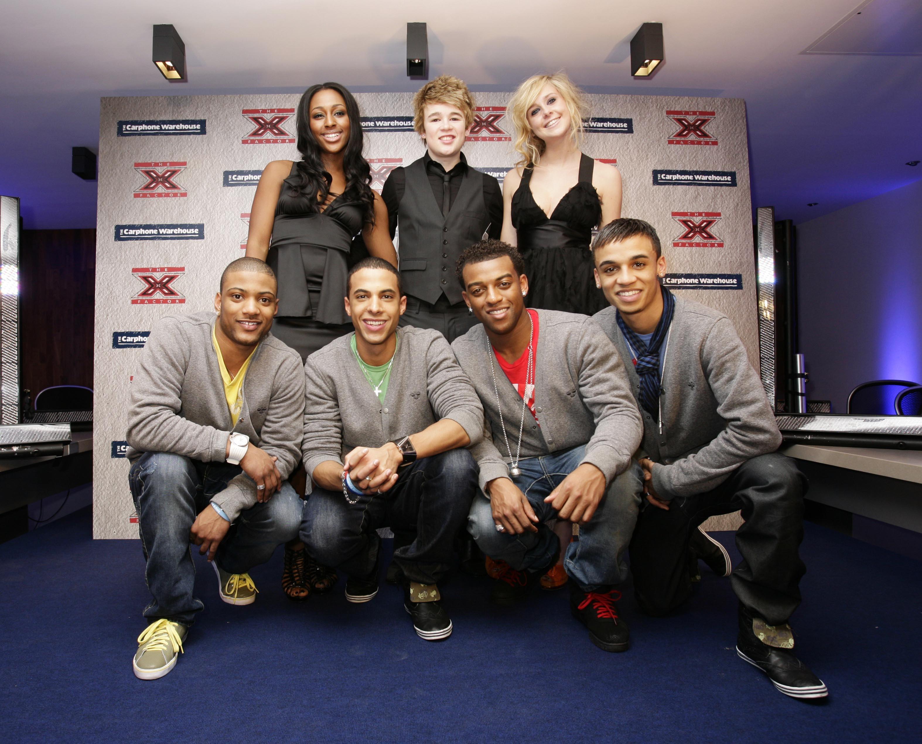 Alexandra Burke, Eoghan Quigg, Diana Vickers and boyband JLS (front) at an X Factor gig in 2008. (Yui Mok/PA)