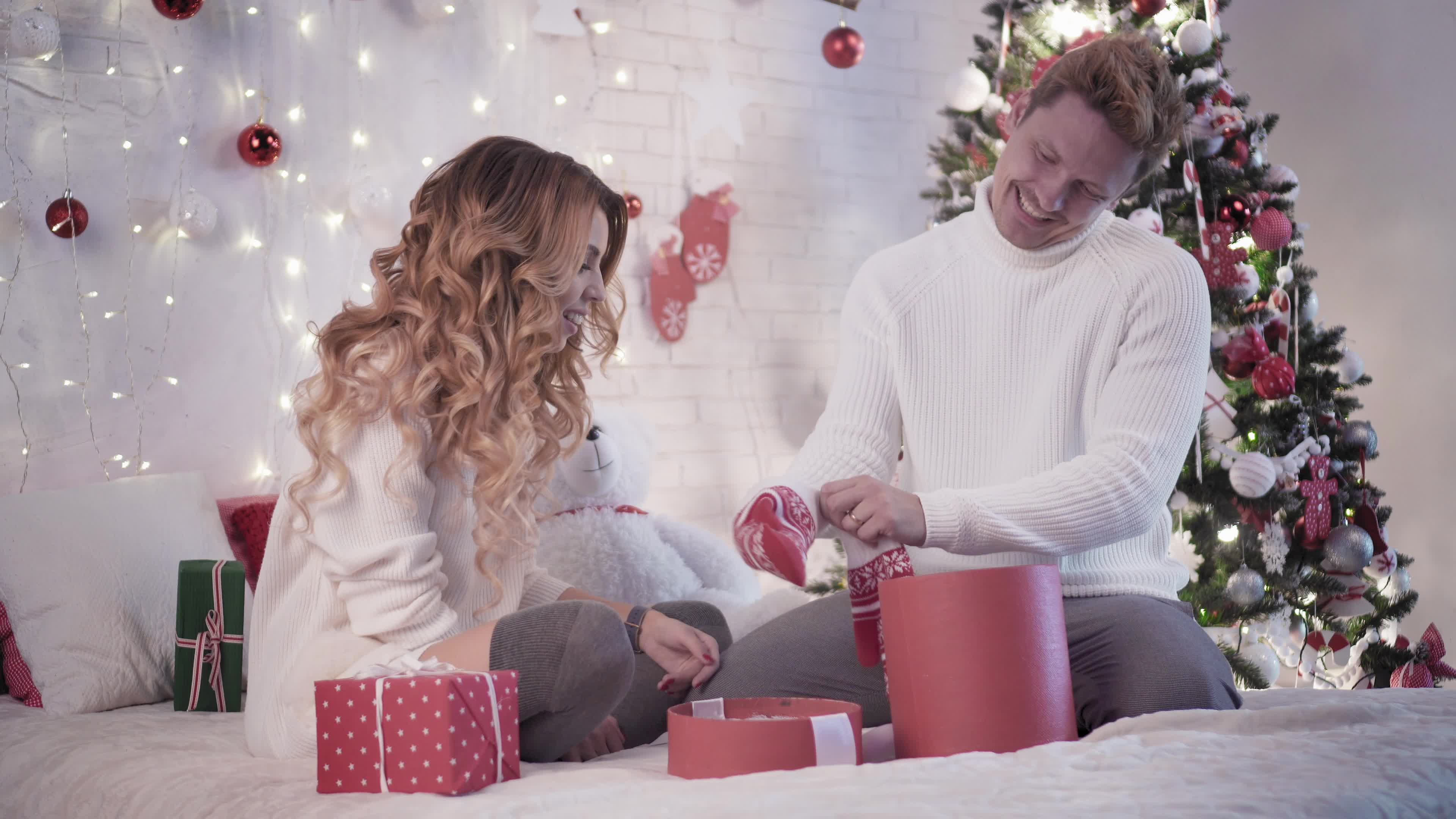 Man and woman exchanging Christmas gifts (Thinkstock/PA)