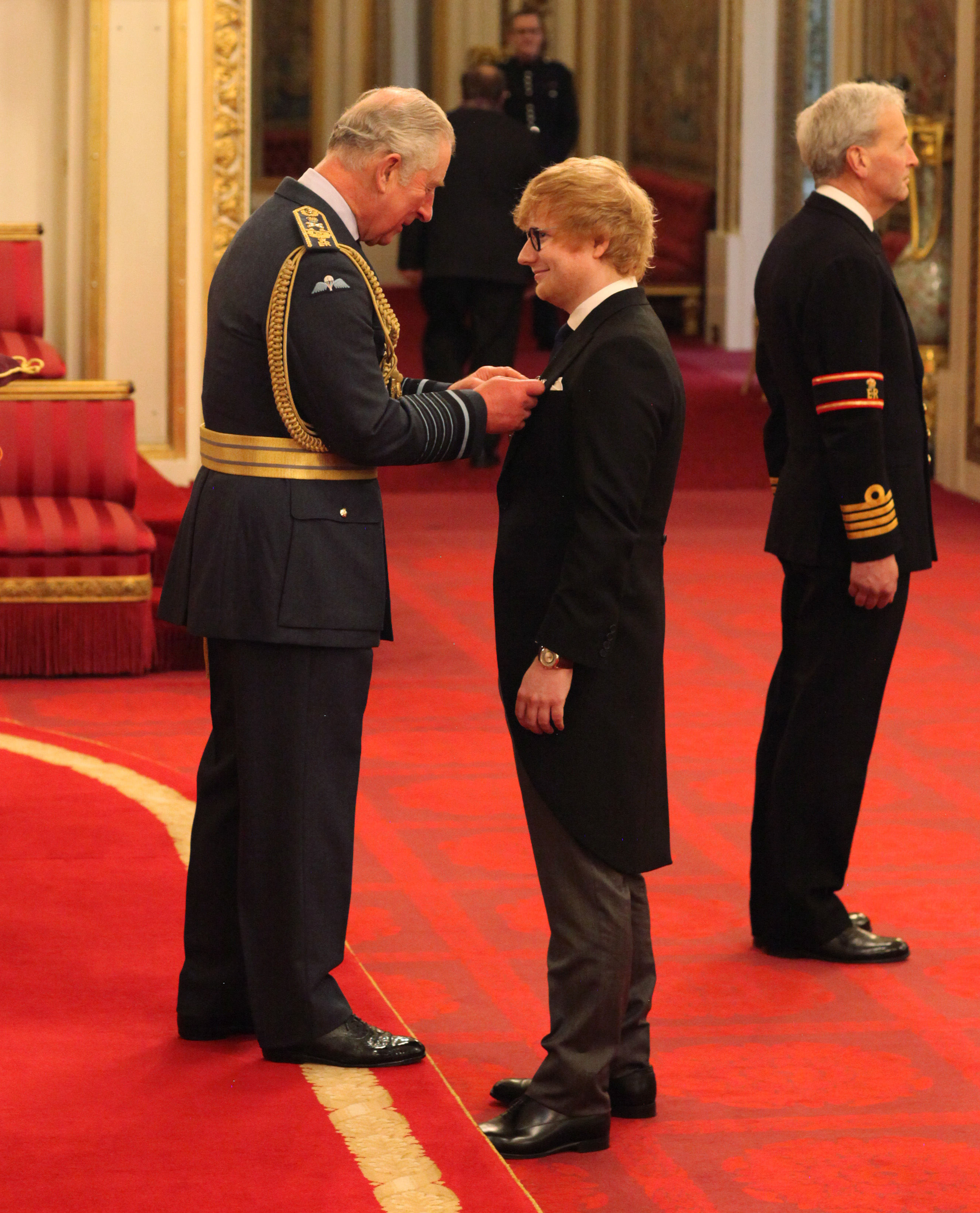 Ed Sheeran is made an MBE by the Prince of Wales at a Buckingham Palace (Yui Mok/PA)