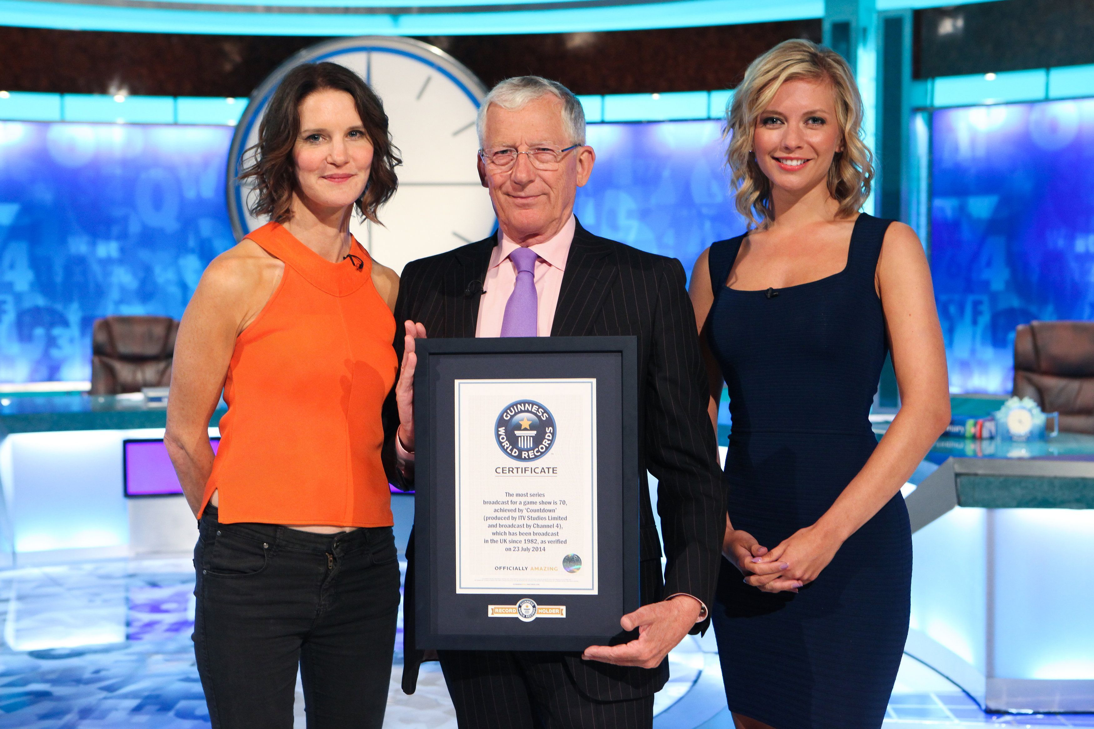 Countdown host Nick Hewer (centre) with the show's Rachel Riley (right) and Susie Dent (left) (Channel 4)
