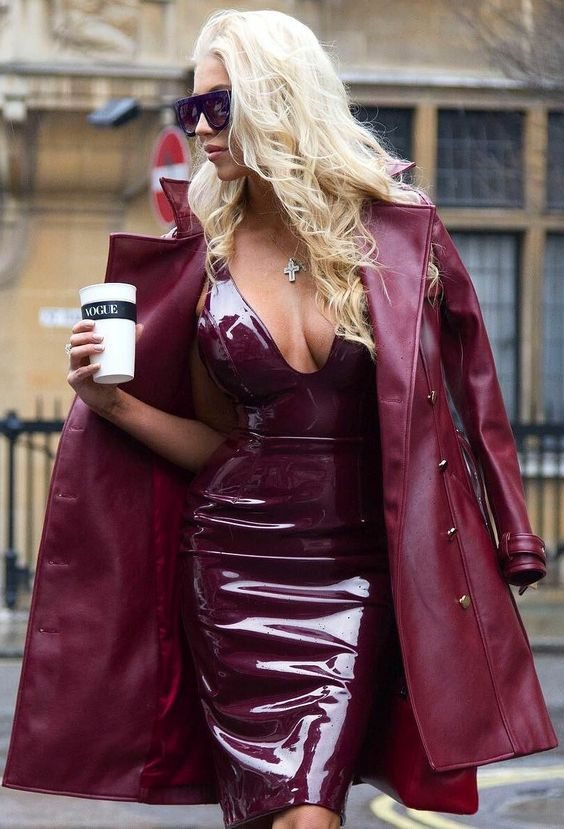 woman wearing a burgundy patent leather dress and coat