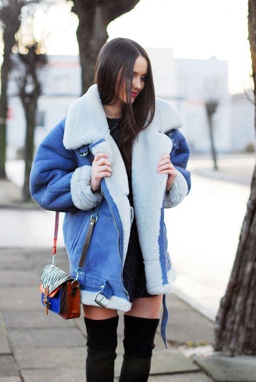 woman wearing a blue shearling jacket