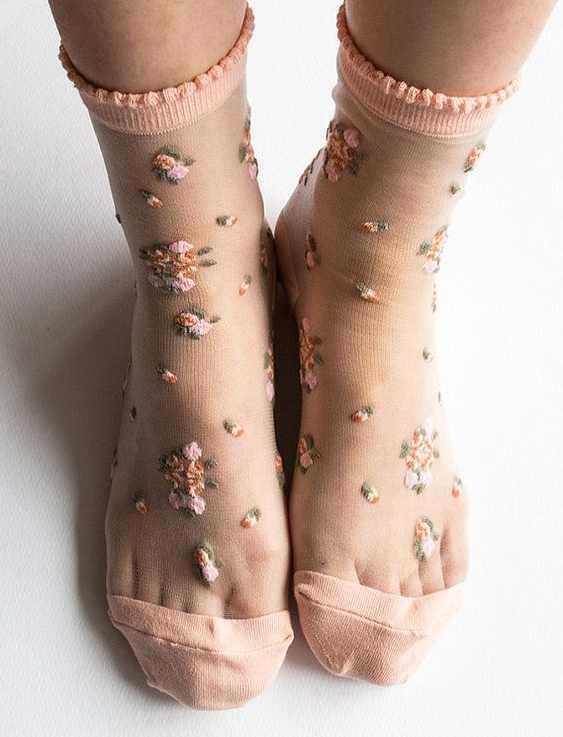 feet wearing sheer peach coloured socks