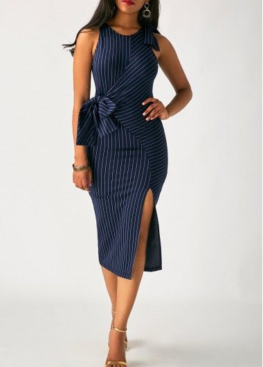 woman wearing a navy blue dress with a side slit