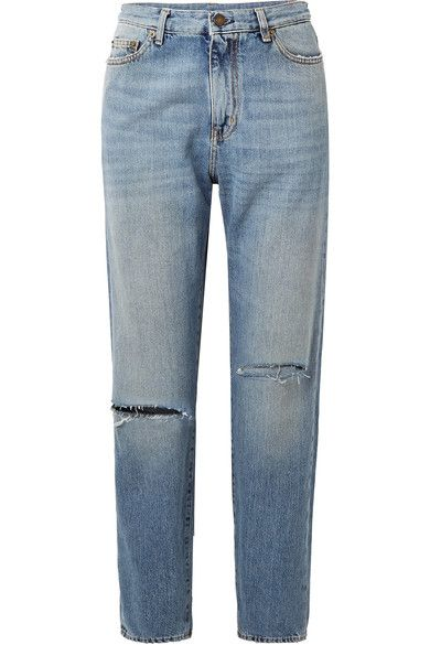 a pair of loose blue jeans