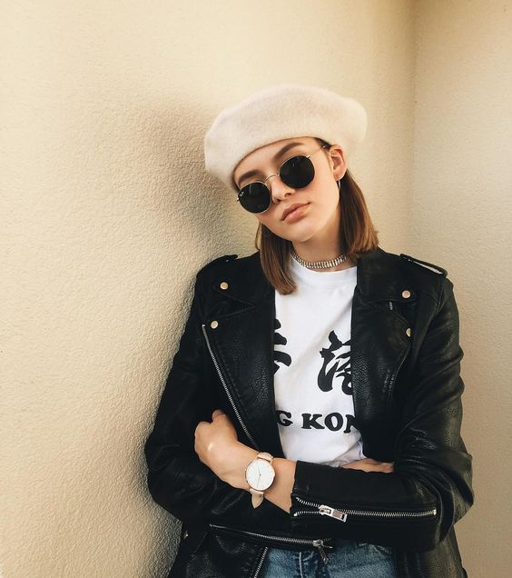 woman wearing a pink beret, white T-shirt and black jacket
