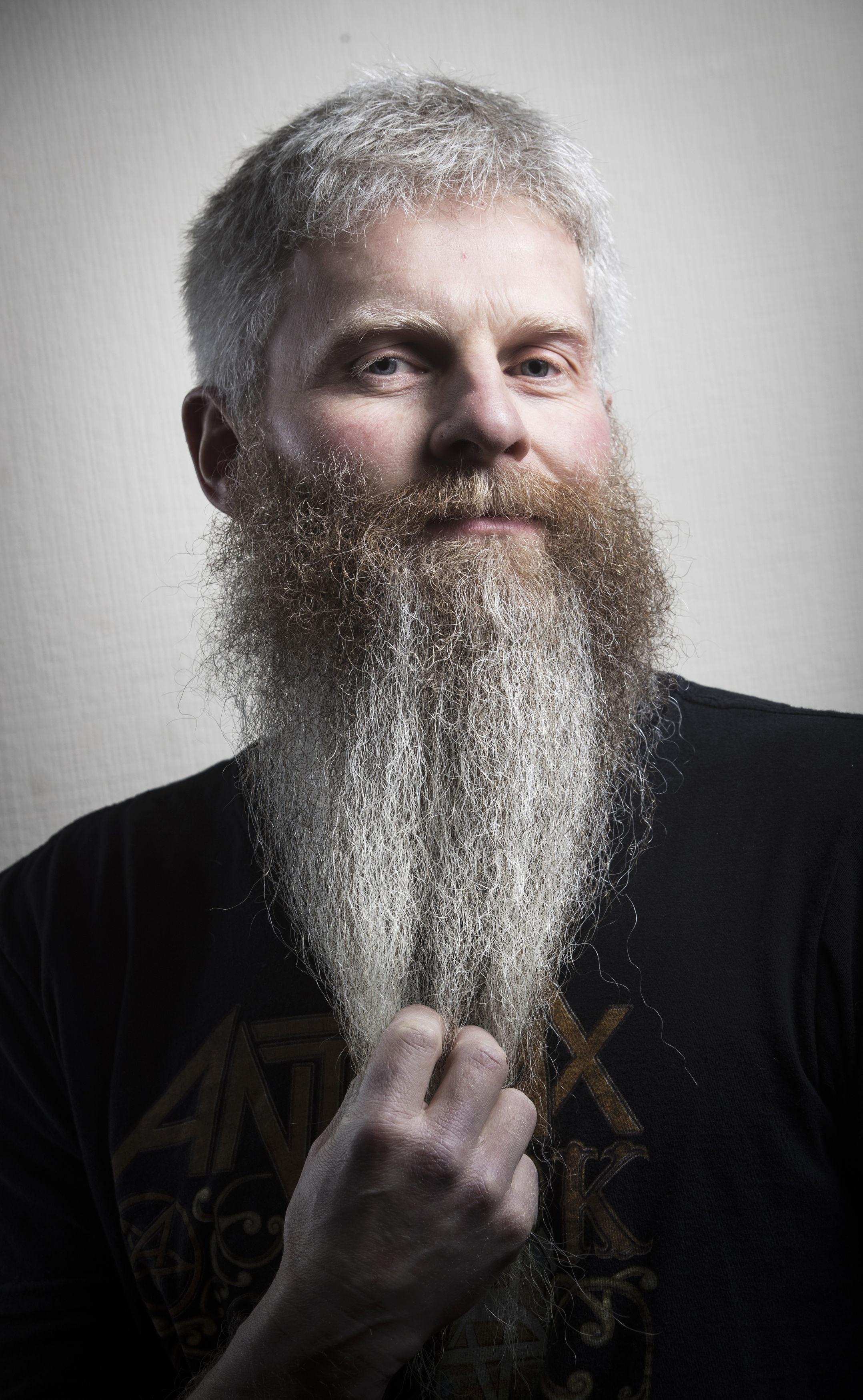 A man stroking his beard