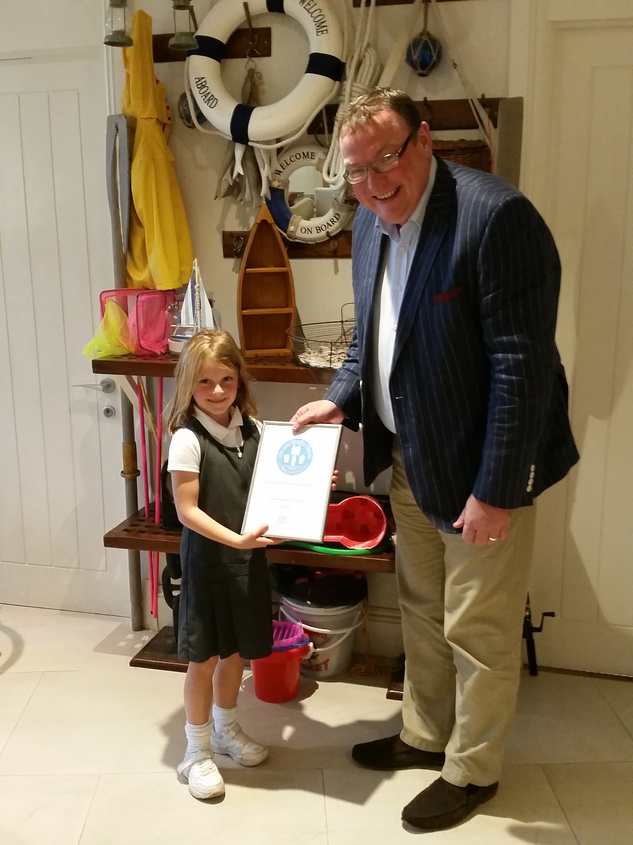 Ella giving an award to the Salcombe Harbour Hotel