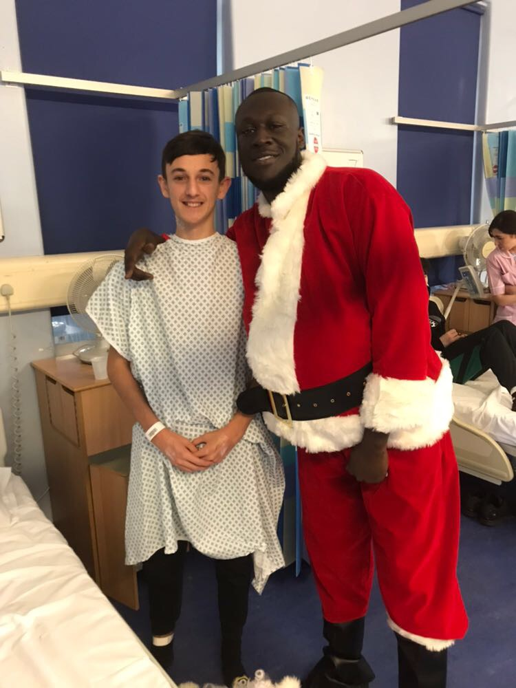 Stormzy with a young patient (Barts Health/PA)