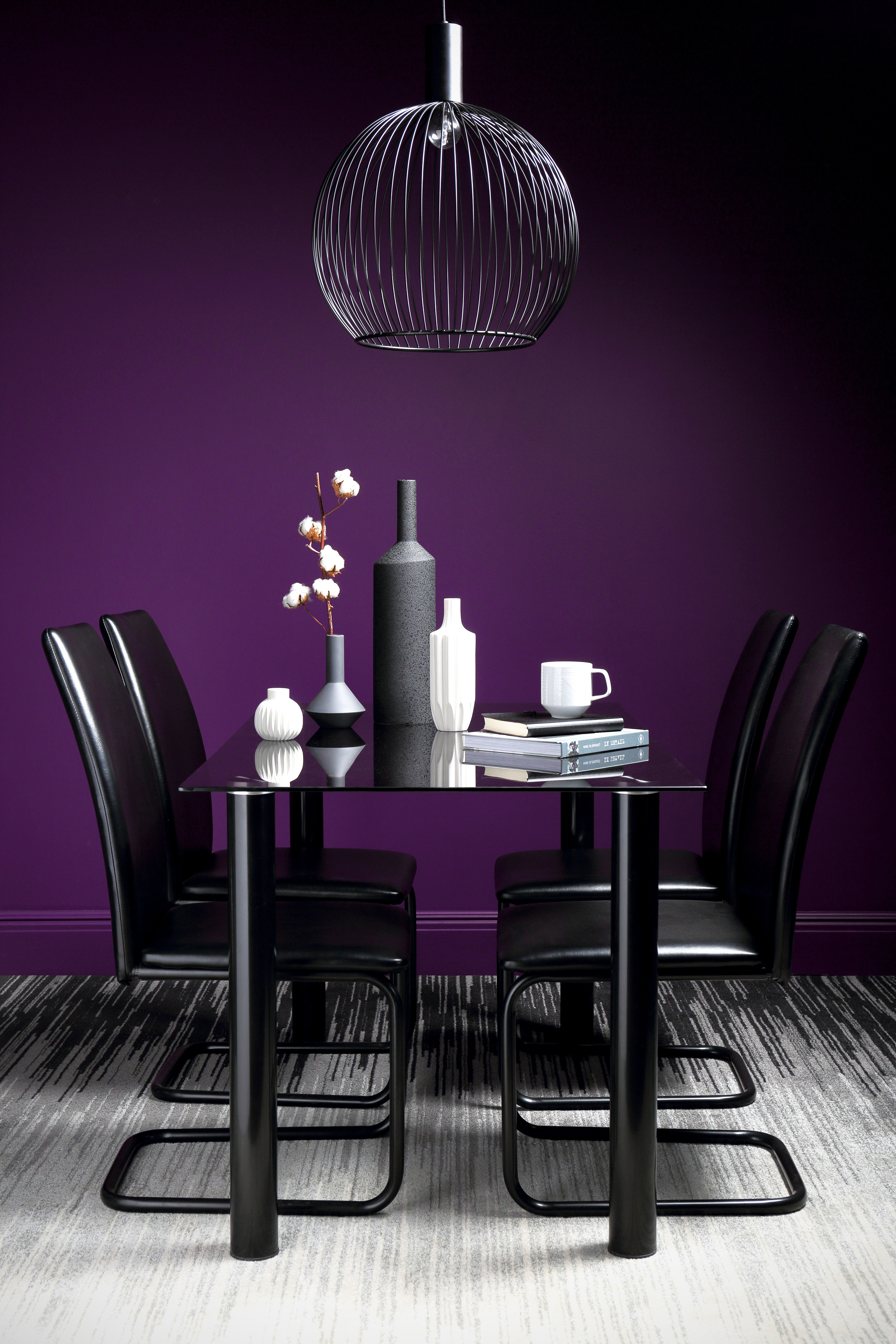 Lunar Black Glass Dining Table with 4 Pica Chairs (also available in purple), currently reduced to £199.99 from £299.99, Furniture Choice (Furniture Choice/PA)