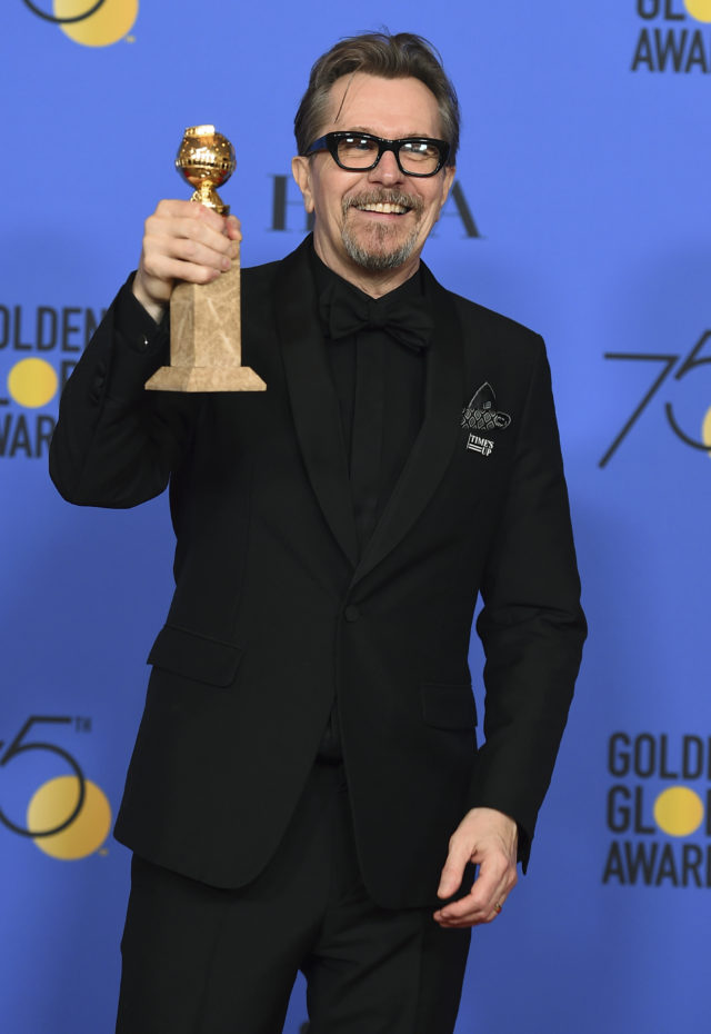 Gary Oldman shows off his Golden Globe