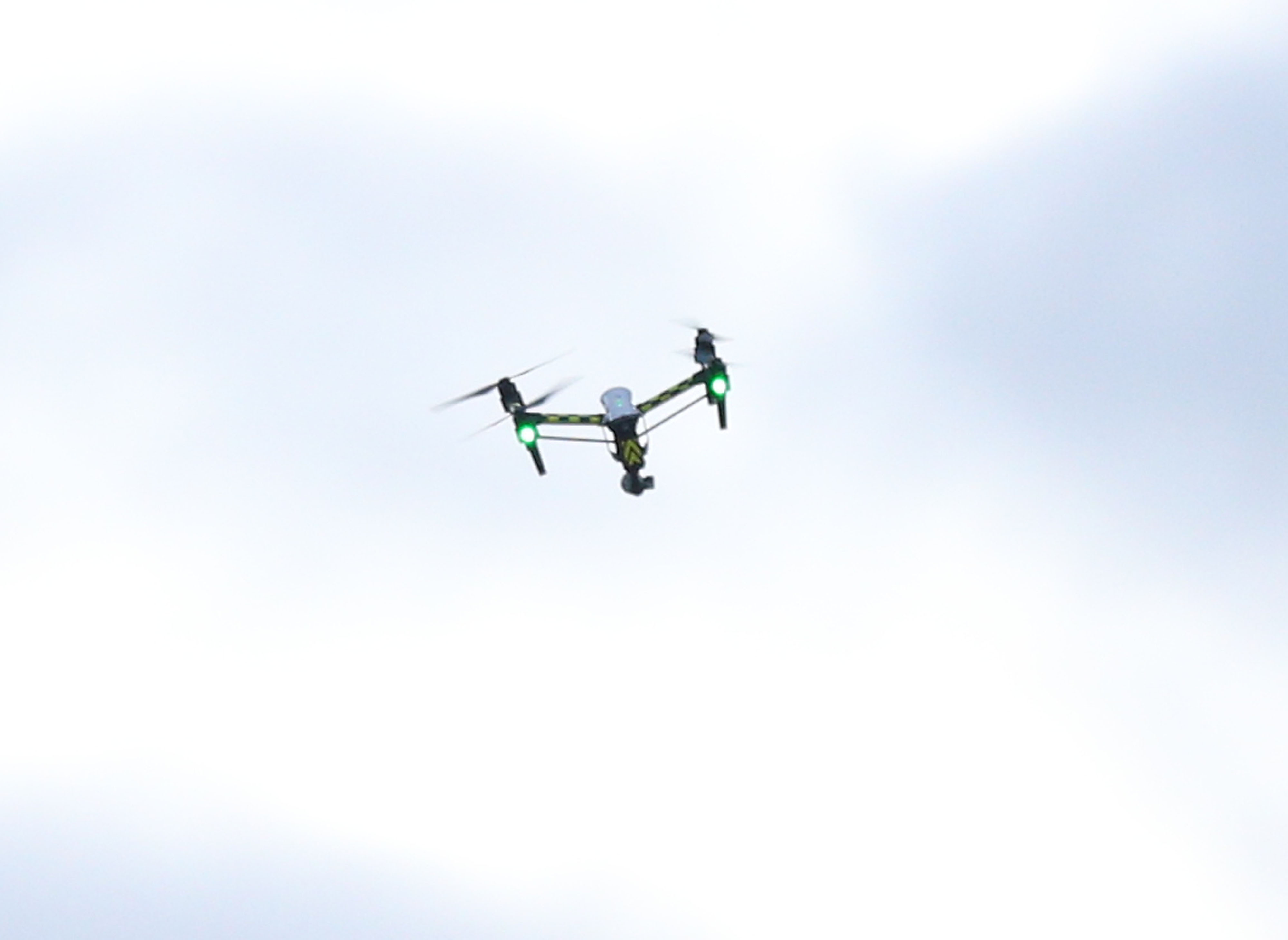 A traditional drone hovers in the air