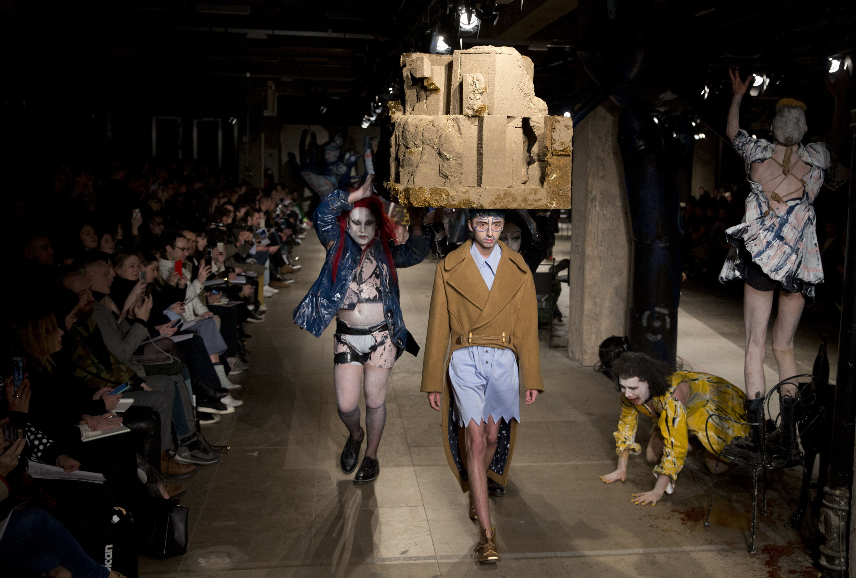 Models on the catwalk during the Charles Jeffrey LOVERBOY London Fashion Week Men's AW18 show, held at Topman Show Space, London.