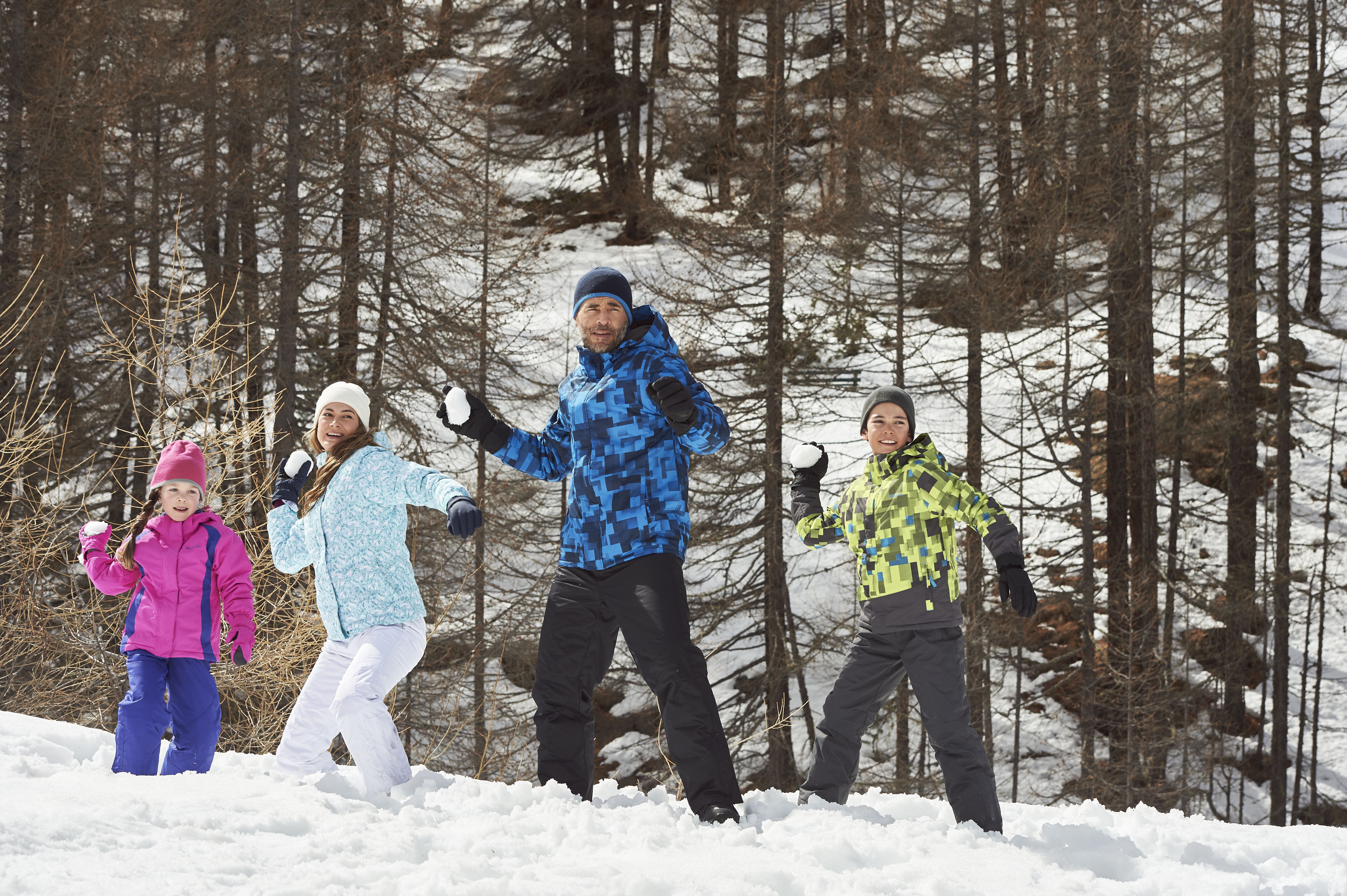 family of four wearing Mountain Warehouse Ski Outfit Packages