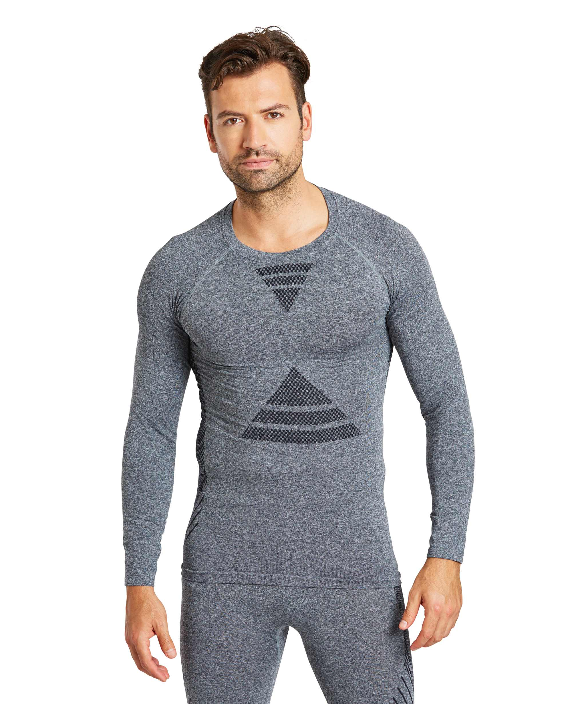 model wearing Zakti Men's Uninterrupted Seamless Base Layer Top Dark Grey and Seamless Pants