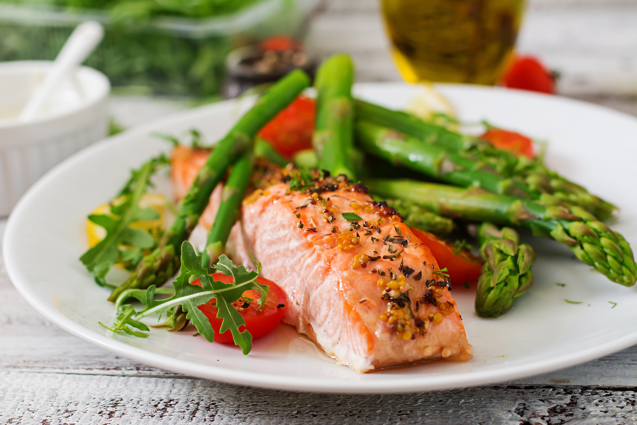 Baked salmon garnished with asparagus and tomatoes with herbs (Thinkstock/PA)