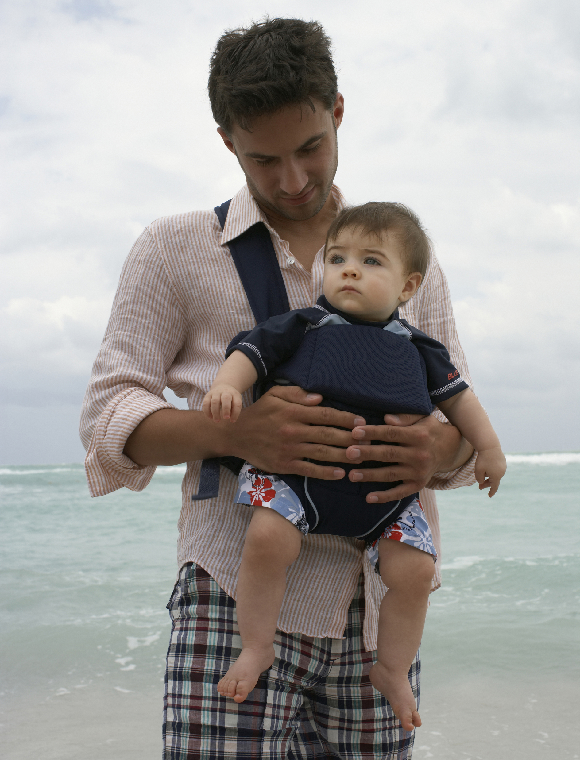 A man carrying his baby in a sling (Thinkstock/PA)