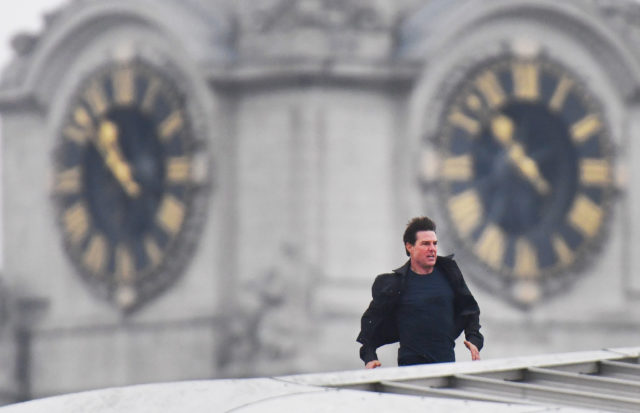 Tom Cruise runs along the rooftop of Blackfriars station in London