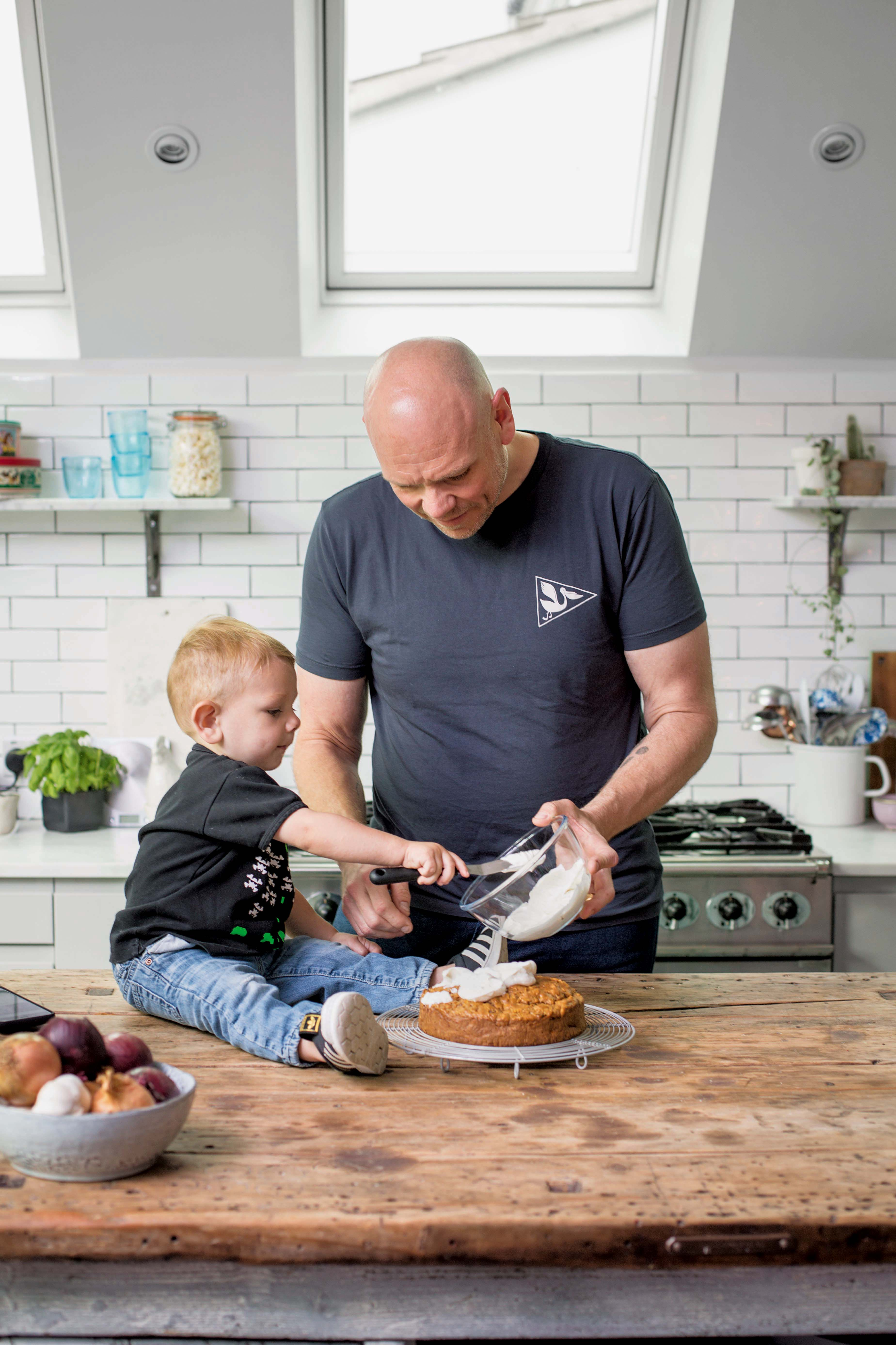 Tom and his two-year-old son making carrot cake with cream cheese frosting (© Cristian Barnett/PA)