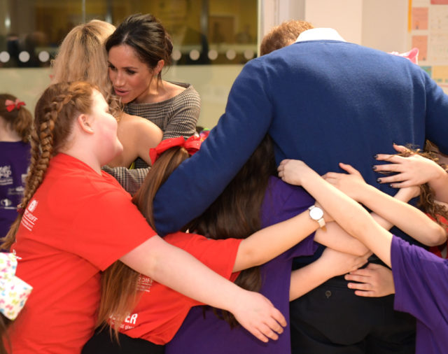 William and Meghan group hug (PA)