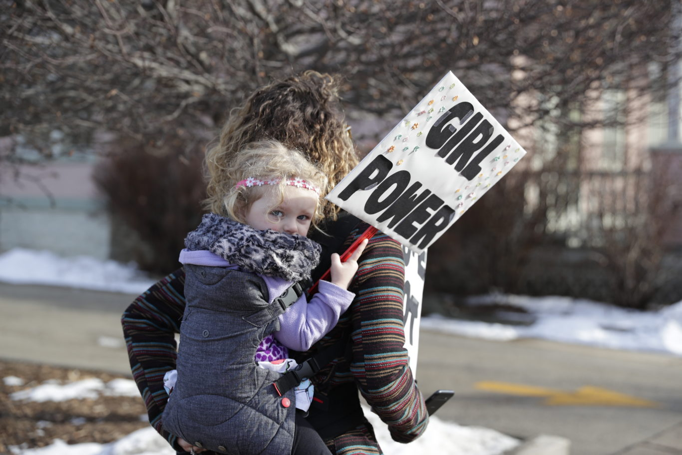 "Peighton Letizia, 3, holds a ""girl power"" sign during a march in Wisconsin, US (Sarah Kloepping/AP)"