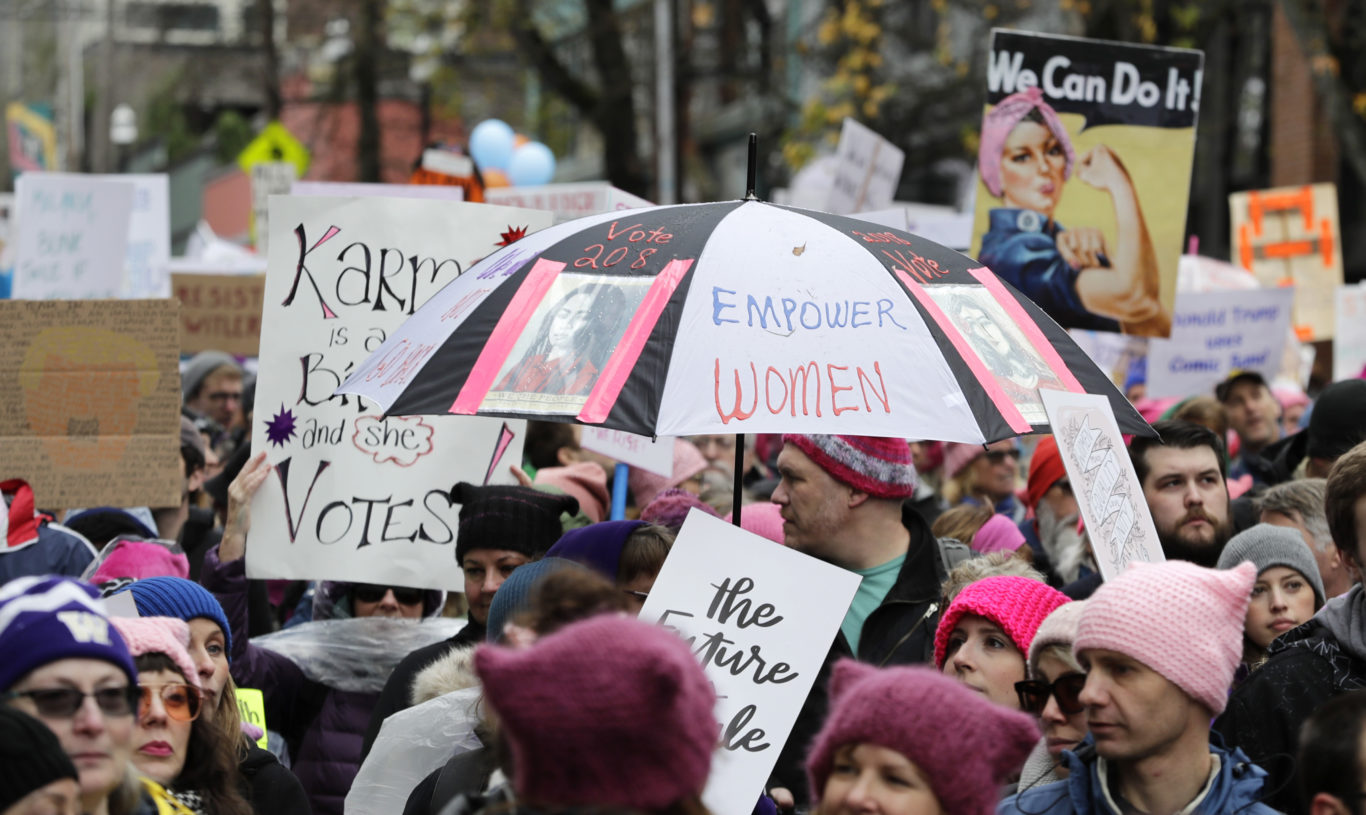 "An umbrella reads ""Empower Women"" in Seattle on Saturday (Ted S. Warren/AP)"